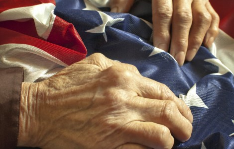 Veteran Hands on Flag 176556018