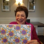 Barbara just finished her work of art as she poses with a smile on her face! Way to go Barbara!