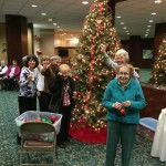 Many residents helping out putting the bulbs on the tree.