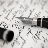 Handwritten letter and fountain pen