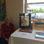 One of our residents displaying her artwork.