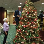 A resident giving directions on where to place the bulbs on the tree.