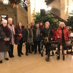 Our eager group upon arrival after a 2 hour drive!  Several residents and guests with Cindy McGuire in the main foyer/entrance at the amazing Breakers Mansion!