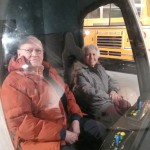 Residents manning  the controls of the spaceship at the Discovery museum trip