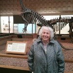 Joan, a assisted living resident at the Inn, with a historic dinosaur