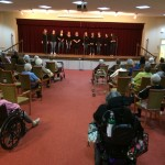 The residents from all communities at The Watermark at 3030 Park were invited to listen to the all female acapella group from Fairfield University, Sweet Harmony.