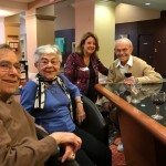 Executive Director, Kristin Butler enjoying time with residents, George, Lis and Joe at the wine & cheese social in the W Lounge!