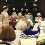 Rabbi Suri with Watermark at 3030 Park residents enjoying Seder.