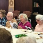 Watermark at 3030 Park residents enjoying Seder