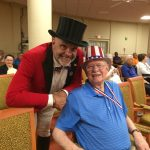 Frank Byrnes, from independent living at The Watermark at 3030 Park with the Barnum Festival Ringmaster.