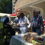 The Director of Dining Services, Pradheep, assisted at the men's lunch cookout at The Watermark at 3030 Park