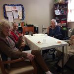 Residents in the Memory Care neighborhood at The Watermark at 3030 Park enjoying the cookies they made.