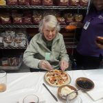 Gardens resident adding the last of her toppings to her yummy creation.