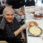 Our Gardens resident excited to be making her own pizza for lunch.