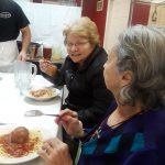 Gardens residents enjoying some spaghetti and meatballs before the pizza making begins.