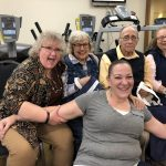 The after party celebration in the Vitality Fitness Center with residents from The Inn and Town Center with two community life associates.