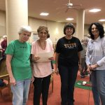 A foursome, the Golden Oldies, who playing in the mini golf tournament at the Watermark at 3030.,