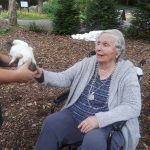 Our Inn community resident at The Watermark at 3030 Park enjoying herself while meeting a new friend.