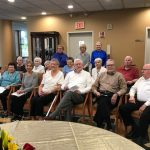 The residents chorus performing for the 50th year Anniversary at The Watermark at 3030 Park in the main lounge  in the independent living neighborhood.
