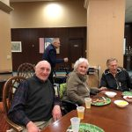 Superbowl Sunday festivities with pizza and beer for the residents in the independent living neighborhood at The Watermark at 3030 Park.