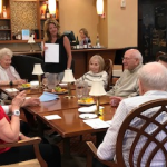 Executive Director, Kristin Butler with residents in the W Lounge for