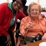 Watermark at 3030 Independent living resident Elaine K. enjoying a glass of wine!