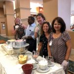 The associates serving the ice cream was having fun of their own at the social in the independent living neighborhood  at The Watermark at 3030 Park.